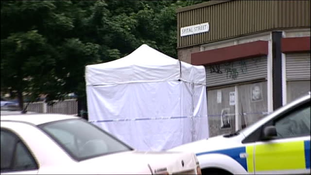 sheffield ext police forensic tent and police vehicles outside barber shop in spital street - sheffield stock videos and b-roll footage