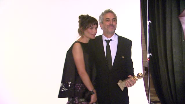 Sheherazade Goldsmith and Alfonso Cuaron at 71st Annual Golden Globe Awards Backstage at The Beverly Hilton Hotel on in Beverly Hills California