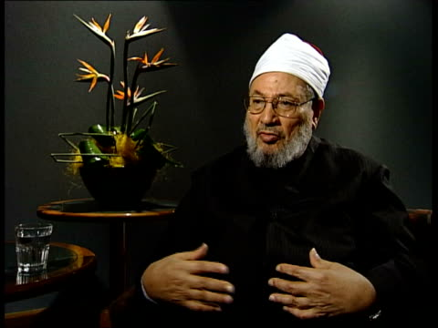 sheikh yusuf alqaradawi interview sot it is sufficent for a muslim to object to it verbally or at least in his conscience / not required by our faith... - prophet stock videos and b-roll footage