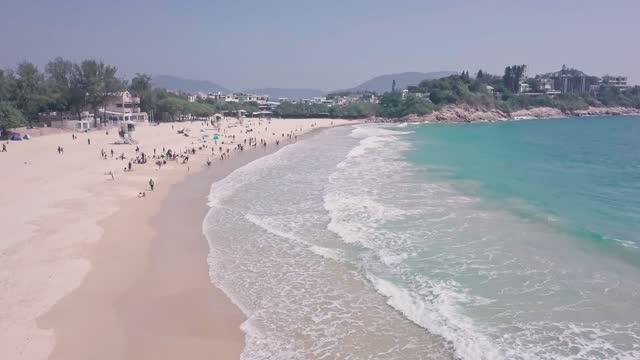stockvideo's en b-roll-footage met shek o beach, a white sandy stretch of sand in hong kong island. aerial drone view - hong kong