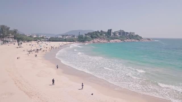 stockvideo's en b-roll-footage met shek o beach, a white sandy tropical landscape in hong kong island. aerial drone view - hong kong