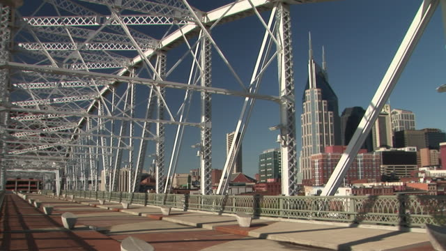 ms, pan, shelby street pedestrian bridge and downtown skyline, nashville, tennessee, usa - nashville stock videos and b-roll footage