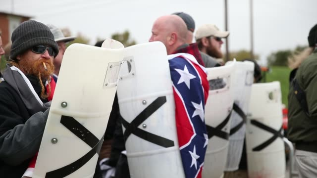 a group holds shields while wearing confederate flags as white nationalist groups gather for a white lives matter rally in downtown shelbyville... - confederate flag stock videos & royalty-free footage