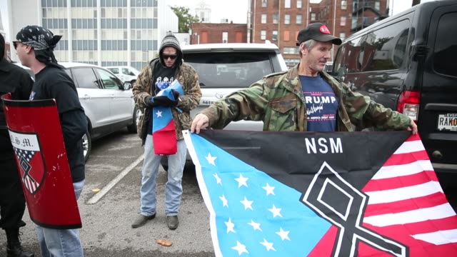 a member of the national socialist movement holds a flag before white nationalist groups gather for a white lives matter rally in downtown... - nazism stock videos & royalty-free footage