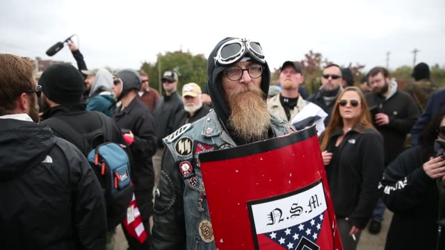 A member of the National Socialist Movement speaks to video journalists as White Nationalist groups gather for a White Lives Matter rally in downtown...