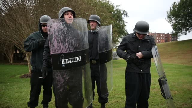 members of the traditional workers party hold shields while waiting before white nationalist groups gather for a white lives matter rally in downtown... - shield stock videos & royalty-free footage