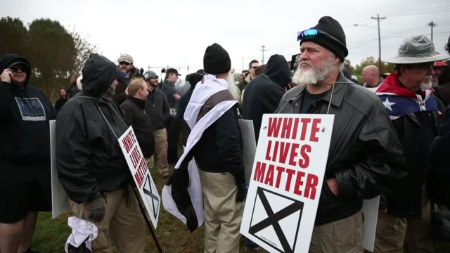 Participants hold White Lives Matter signs as White Nationalist groups gather for a White Lives Matter rally in downtown Shelbyville Tennessee The...