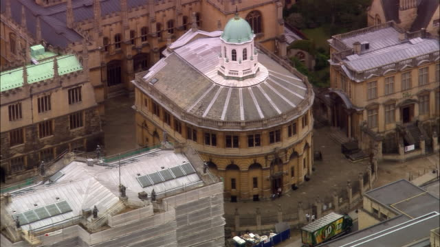 aerial, sheldonian theatre, oxford, england - oxford england stock videos & royalty-free footage