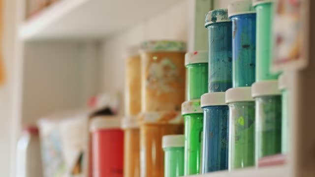 shelf of paints in artist's studio - shelf stock videos & royalty-free footage