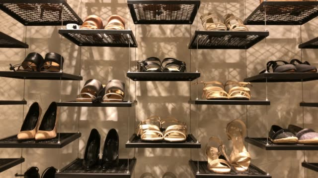 shelf of shoes in retail store at shopping mall