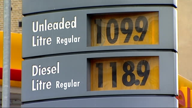 stockvideo's en b-roll-footage met london ext general views of shell petrol station including uleaded petrol and diesel prices displayed and woman filling her car at petrol pump - shell merknaam