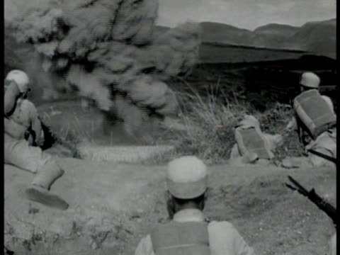 shell burst in open field explosion near nationalist chinese soldier's trenches nationalist chinese soldiers firing rifles from trenches bren machine... - indocina video stock e b–roll