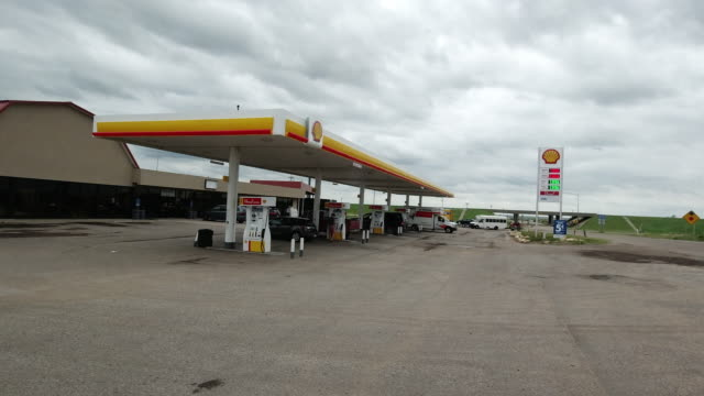 shell gas station opening for business amid the 2020 global coronavirus pandemic - refueling stock videos & royalty-free footage