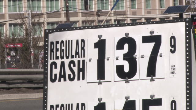 a shell station near the george washington bridge has dropped its cash price for 87 octane regular gasoline to $137 per gallon / montage includes... - gallon stock videos and b-roll footage