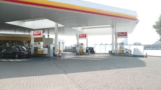 A Shell tanker truck arrives and departs making a delivery at a gas station operated by Royal Dutch Shell Plc in Rotterdam Netherlands on Wednesday...