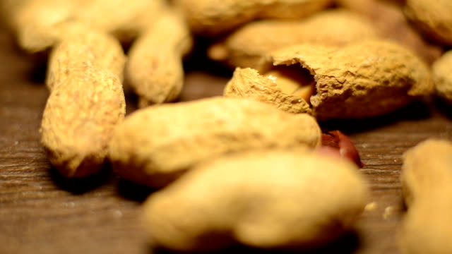 shelled peanuts,raw peanuts. - peanut food stock videos & royalty-free footage
