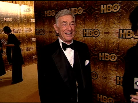HANDHELD Shelley Berman standing on carpet in Beverly Hilton hotel posing for camera