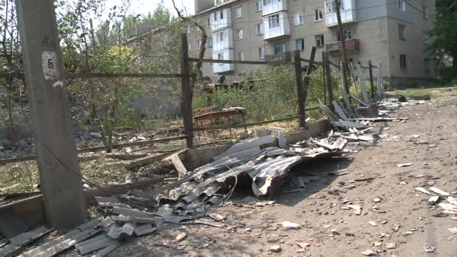 Shells damaged a former army recruitment centre offices and an apartment building in southern Donetsk Ukraine on Monday morning