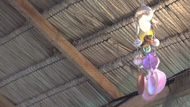shells mobile hanging on roof for decoration. - hanging mobile stock videos & royalty-free footage