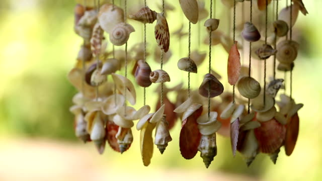 shells mobile hanging on roof for decoration. - market stall stock videos & royalty-free footage
