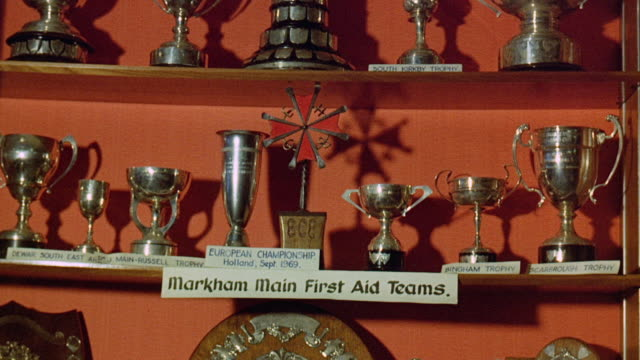 1971 td shelves lined with first aid trophies / united kingdom - auszeichnung stock-videos und b-roll-filmmaterial