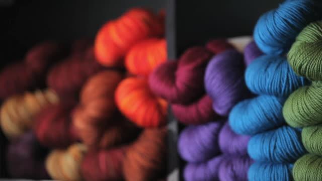 cu pan shelves of colored yarn / richmond, virginia, usa - ball of wool stock videos & royalty-free footage