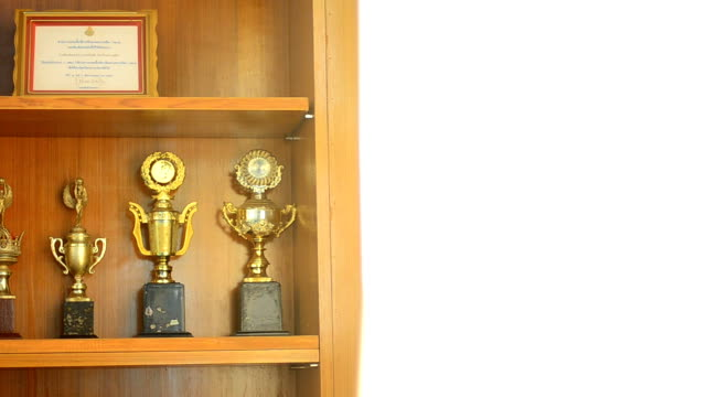 shelves of trophies - award stock videos & royalty-free footage