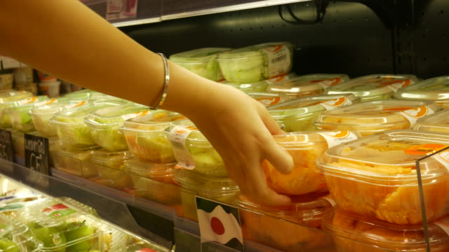 Shelves with fresh food in retail store
