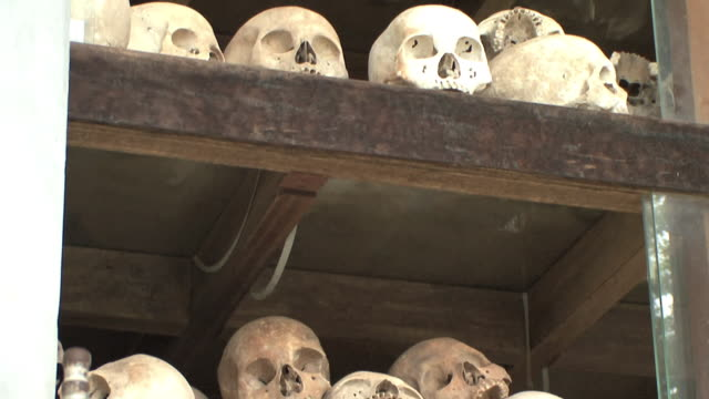 ms tu shelves with skulls, choeung ek, cambodia - mass grave stock videos and b-roll footage