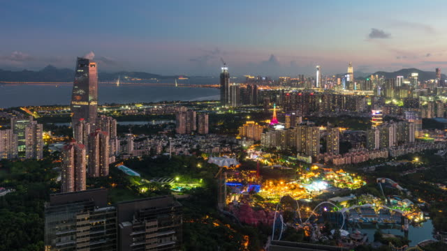 t/l ha ws shen houhai financial district skyline time-lapse from dusk to night/shenzhen,china - geographical locations stock videos & royalty-free footage