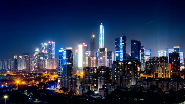 shenzhen downtown district  skyline from dusk to night/4k time lapse - global finance stock videos & royalty-free footage