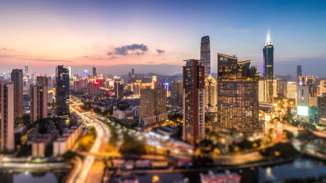 stockvideo's en b-roll-footage met shenzhen skyline van de financiële centrum van dag naar nacht, tijd vervallen/shenzhen, china - welvaart