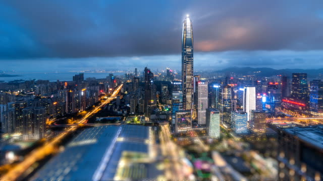 shenzhen financial district building skyline from dusk to night.time lapse/shezhen,china. - financial building stock videos & royalty-free footage