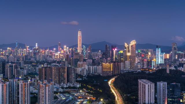 t/l ms ha shenzhen skyline von tag zu nacht transiton/shenzhen,china - zeitraffer tag bis nacht stock-videos und b-roll-filmmaterial