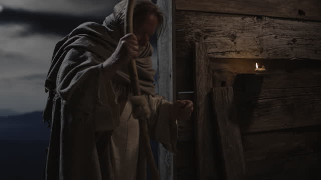 shepherd entering barn doorway at night / cedar hills, utah, united states - キリスト降誕点の映像素材/bロール