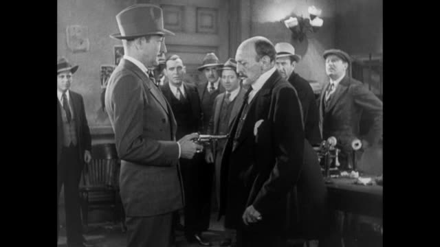 1931 sheriff questions reporter (pat o' brien) who throws gun to editor (adolph menjou) - 1931 stock videos & royalty-free footage