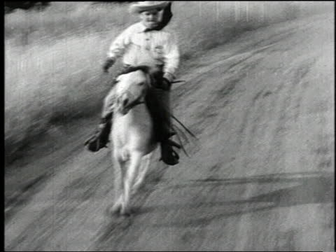 1938 montage sheriff riding pony and chasing a stagecoach in the film 'terror of tiny town' / united states - wild west stock videos & royalty-free footage
