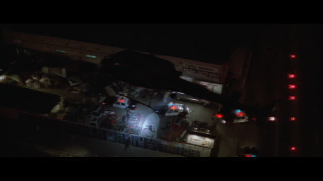 AIR TO AIR, CIRCLING, Sheriff's helicopter hovering above police cars at warehouse, night, USA