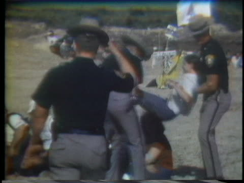 sheriffs remove demonstrators from the construction site of a nuclear power plant in hampton falls, new hampshire. - environmentalist stock videos & royalty-free footage