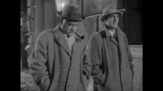 1946 sherlock holmes (basil rathbone) and doctor watson (nigel bruce) discuss the facts of the stolen music box case - sherlock holmes stock videos & royalty-free footage