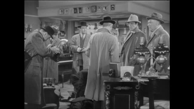 1946 sherlock holmes (basil rathbone) and doctor watson (nigel bruce) visit murder scene to determine theft of music box - murder stock videos & royalty-free footage