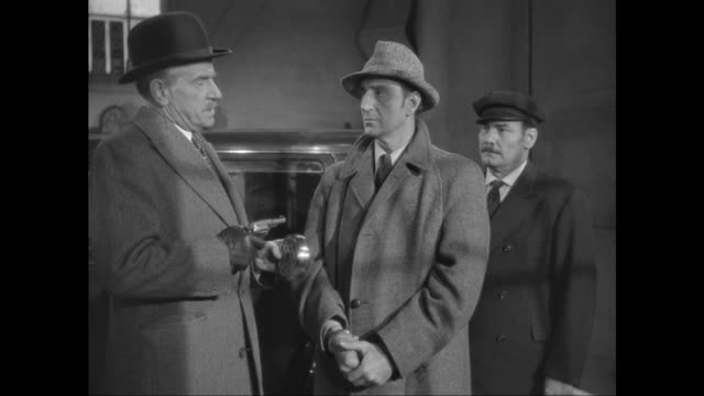 1946 sherlock holmes' (basil rathbone) captors explain how he will die - handcuffs stock videos and b-roll footage