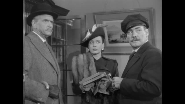 1946 sherlock holmes (basil rathbone) captures woman (patricia morison) and gang stealing bank note plates - dieb stock-videos und b-roll-filmmaterial