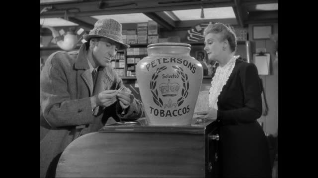 1946 sherlock holmes (basil rathbone) discovers owner of discarded cigarette - sherlock holmes stock videos & royalty-free footage