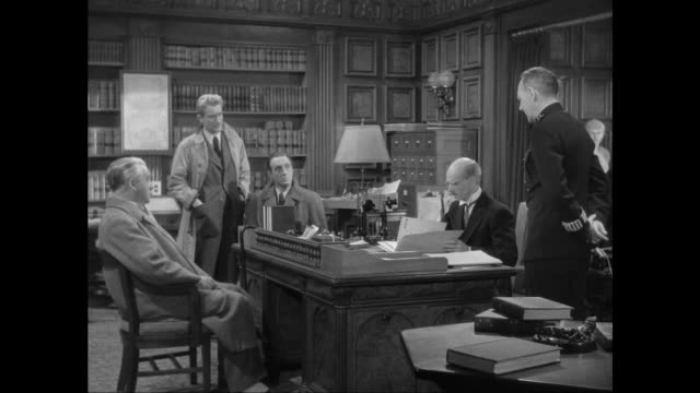 1946 sherlock holmes (basil rathbone), doctor watson (nigel bruce) and police discuss criminal who created stolen music boxes - sherlock holmes stock videos & royalty-free footage