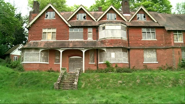 sherlock holmes house threatened by development england surrey hindhead gvs exterior of derelict undershaw house where arthur conan doyle wrote... - arthur conan doyle stock videos & royalty-free footage