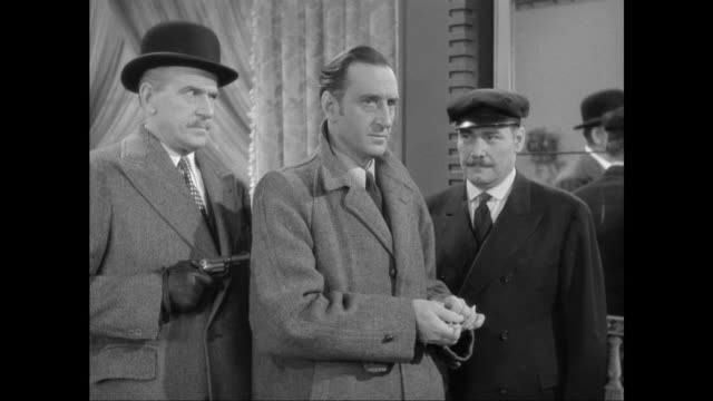 1946 sherlock holmes (basil rathbone) is escorted outside by his captors - sherlock holmes stock videos & royalty-free footage