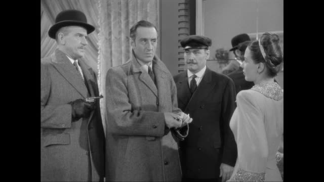 1946 sherlock holmes (basil rathbone) is trapped by crafty criminal (patricia morison) - sherlock holmes stock videos & royalty-free footage
