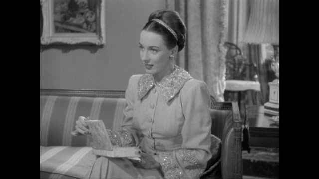 1946 sherlock holmes (basil rathbone) questions an uncomfortable thief (patricia morison) - sherlock holmes stock videos & royalty-free footage