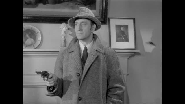 1946 sherlock holmes (basil rathbone) shoots knife throwing criminal - sherlock holmes stock videos & royalty-free footage